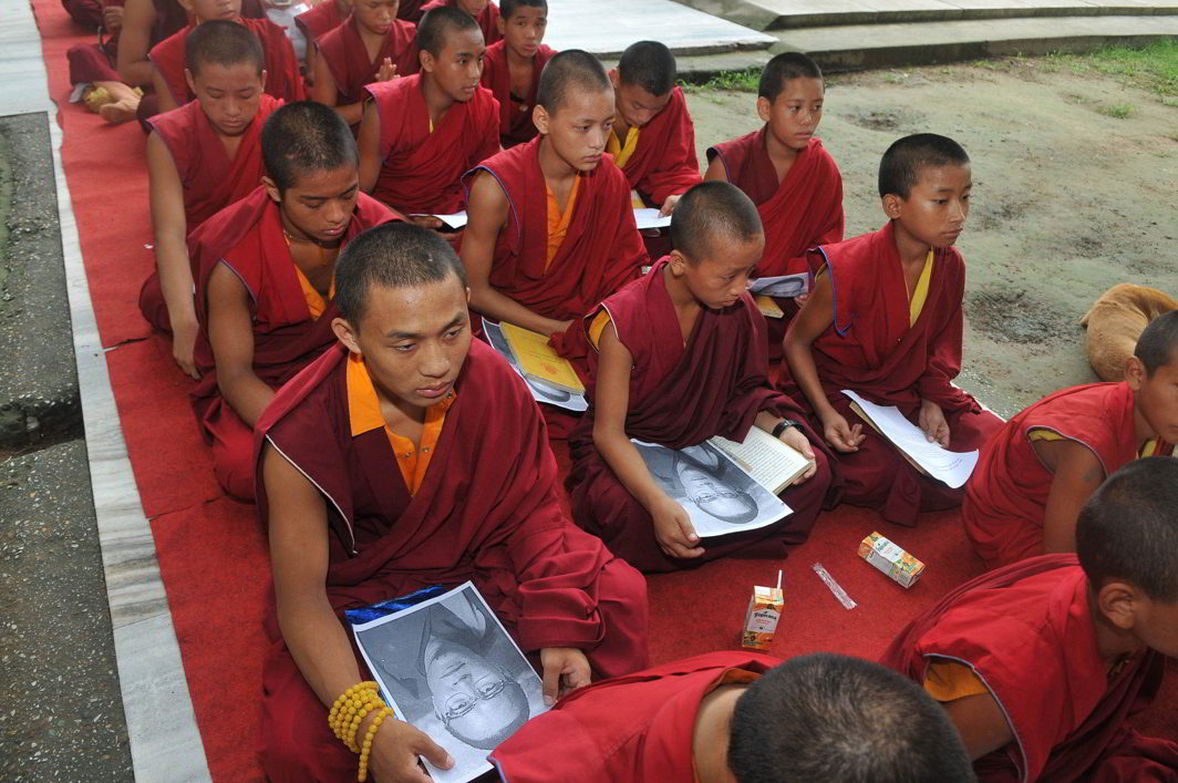 Monks in Bodhgaya pray for Akong Tulku Rinpoche, who was reported killed in China. Photo: UNI