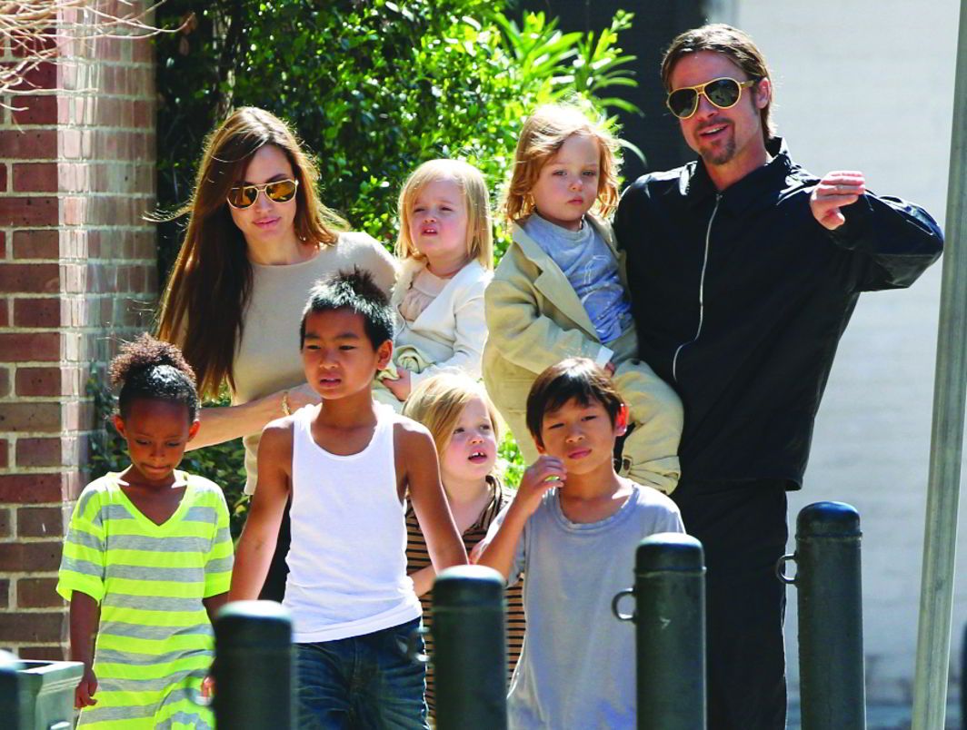 Angelina Jolie and Brad Pitt with their six multi-cultural adopted kids