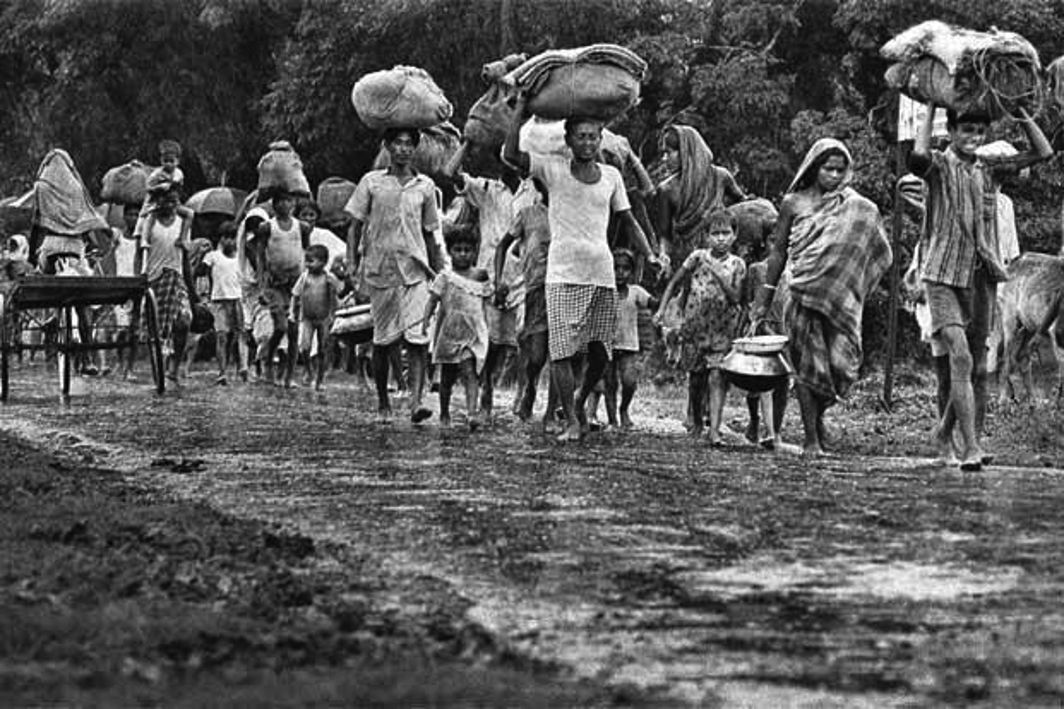 Bangladeshi Hindus trudge to India during the 1971 war; despite huge migration, they still comprise close to nine percent of the population. Photo: www.defencebd.com