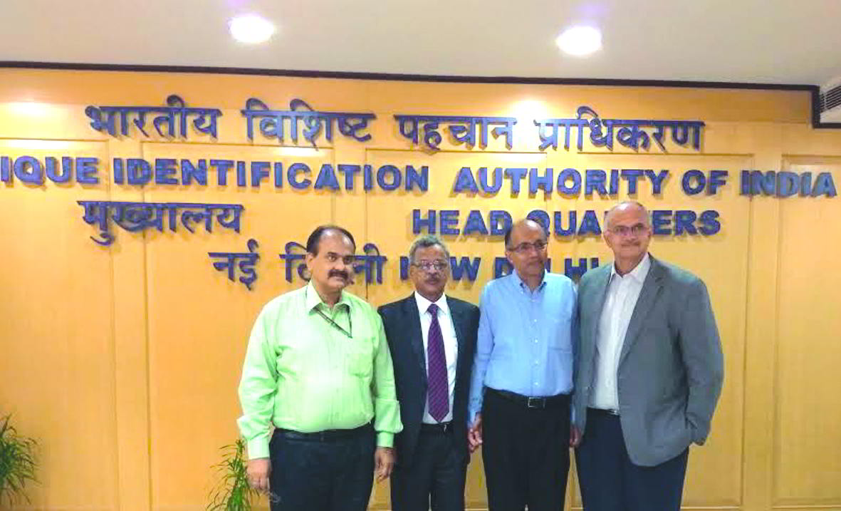 UIDAI chairperson J Satyanarayana (second from left) needs to address many questions. Photo: uidai.gov.in