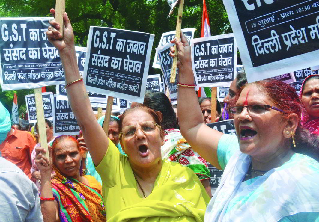 Congress workers raising slogans at a protest rally against GST in New Delhi. Photo: UNI