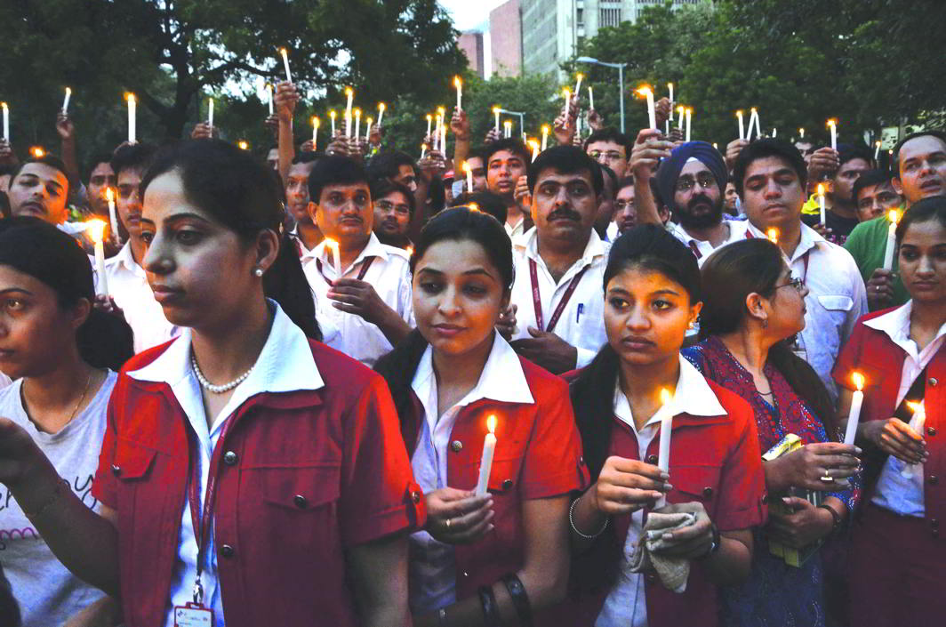 Employees taking out a candlelight march against Vijay Mallya, former chairman of Kingfisher Airlines, in New Delhi