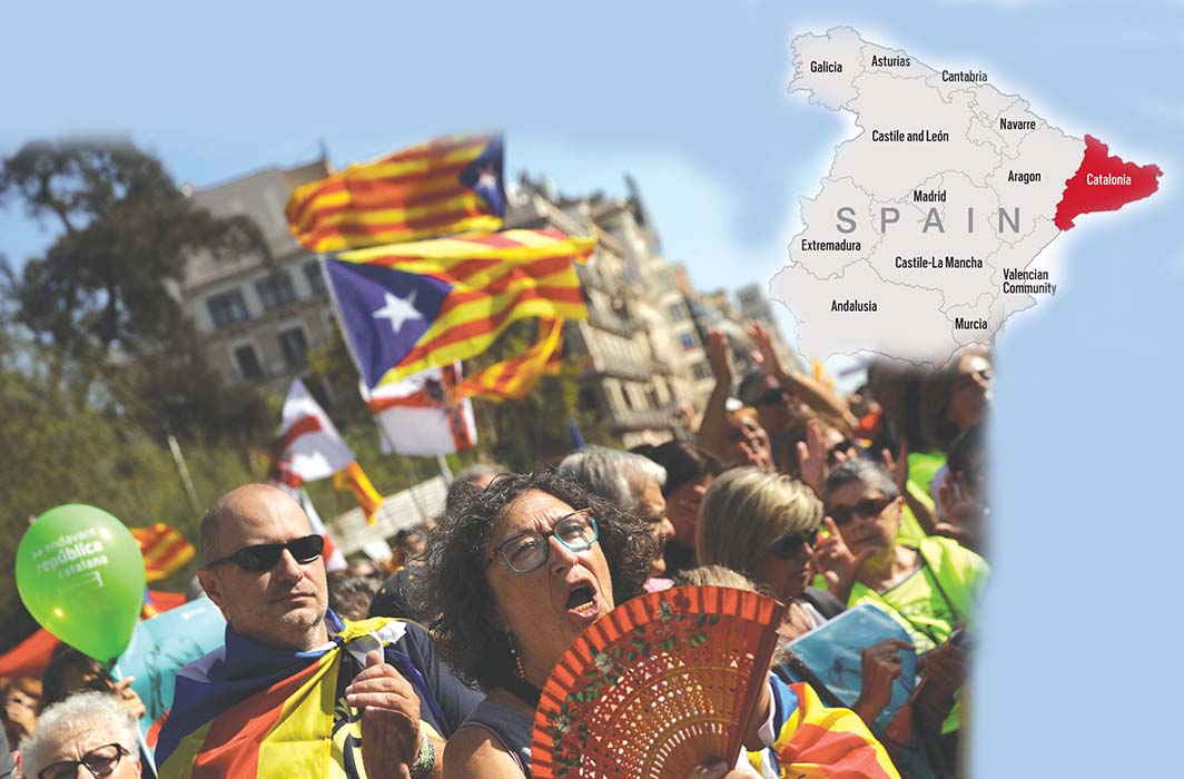 Demonstrators in Barcelona hold up Catalan separatist flags and take part in a gathering in support of the banned October 1 independence referendum. Photo: Rajender Kumar