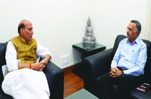 Home minister Rajnath Singh and (right) Tihar Jail DG Ajay Kashyap