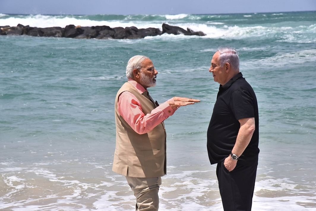Modi in conversation with Netanyahu at Olga Beach in Israel. Photo: UNI