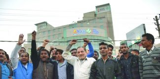 Relatives of a newborn who was wrongly declared dead raise slogans against Max Hospital authorities