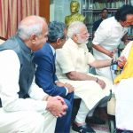 PM Narendra Modi calling on DMK leader M Karunanidhi at his residence in Chennai. Photo: UNI