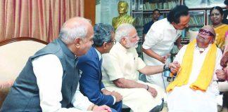 PM Narendra Modi calling on DMK leader M Karunanidhi at his residence in Chennai. Photo: UNI