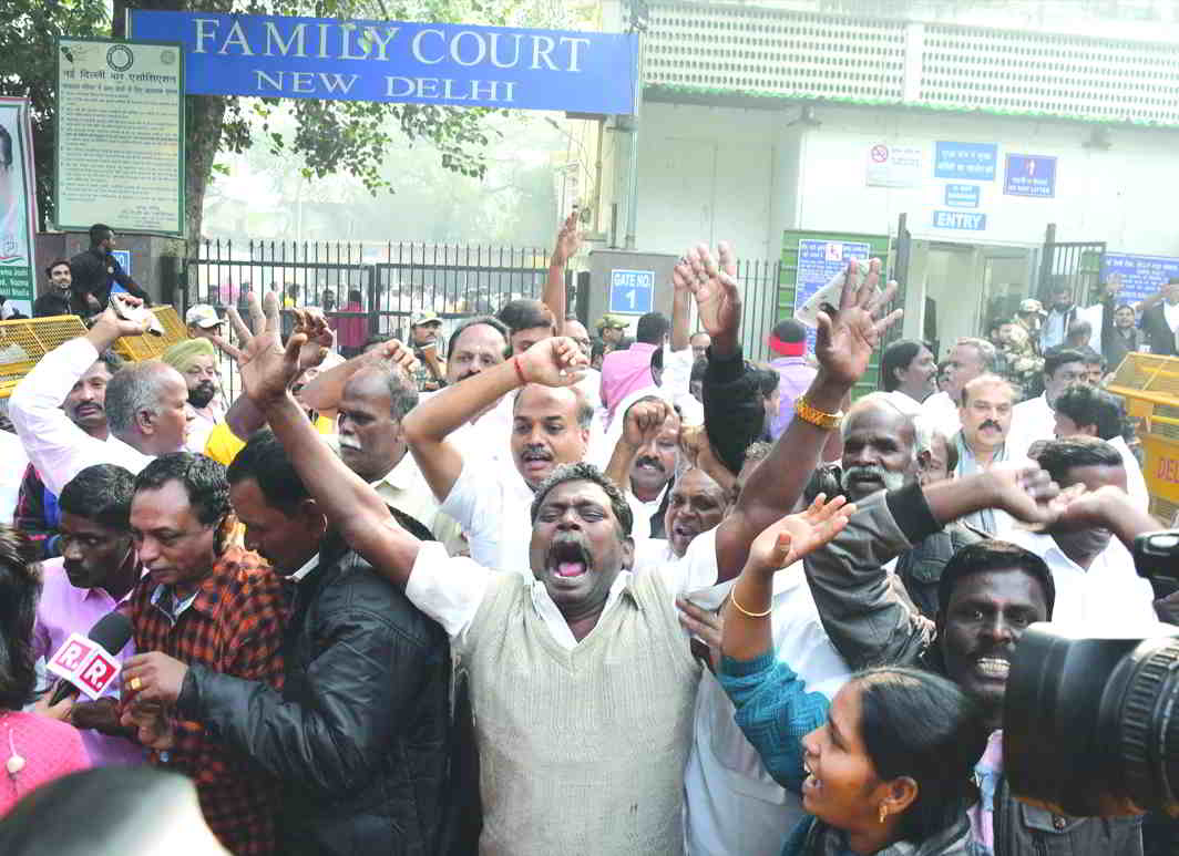 DMK workers rejoice after ex-telecom minister A Raja and party colleague MK Kanimozhi are acquitted in the 2G spectrum case. Photo: UNI