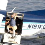 Prime Minister Modi waves to supporters from a seaplane on the Sabarmati