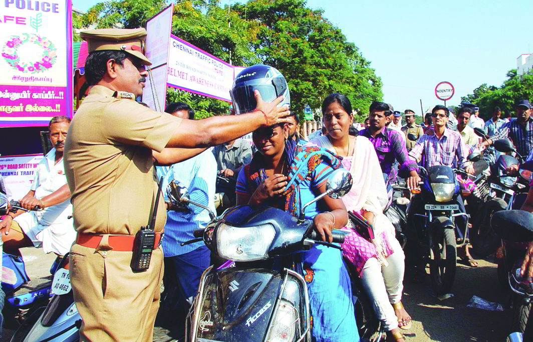 Chennai Traffic Police distribute free helmets during the 26th Road Safety Week held recently