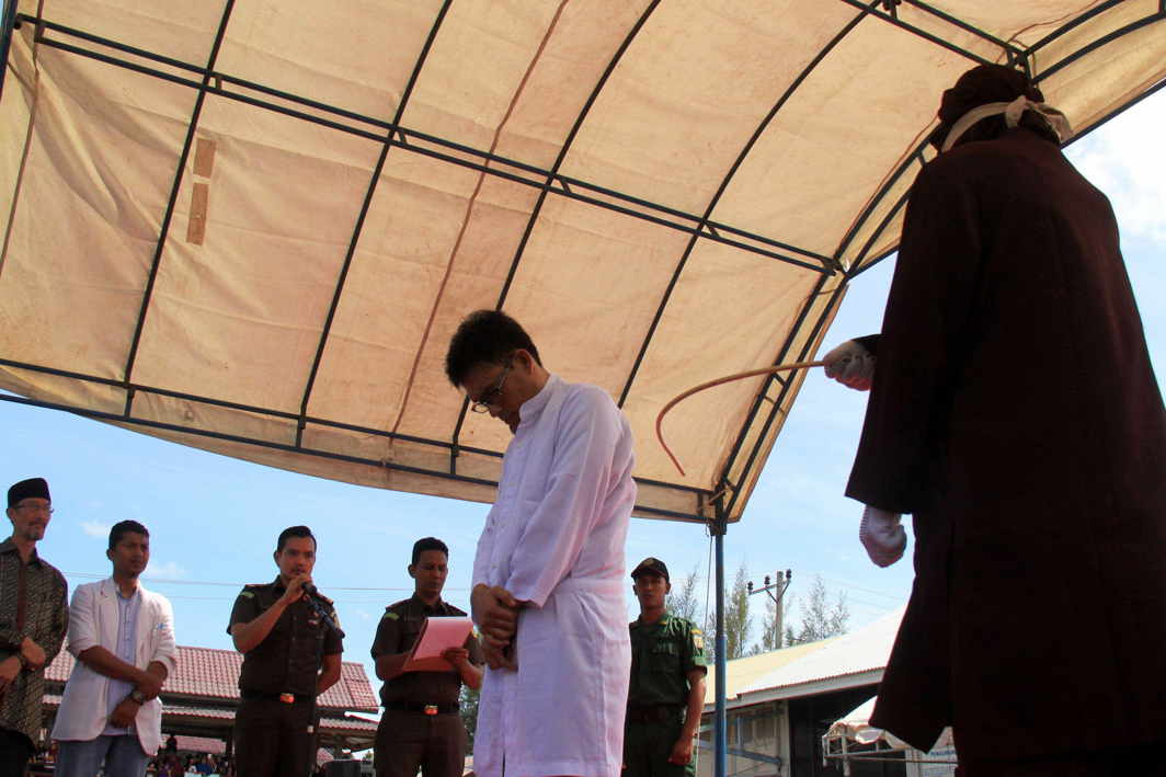 A man being caned for adultery at Al Abrar mosque in Banda Aceh, Indonesia. Photo: UNI