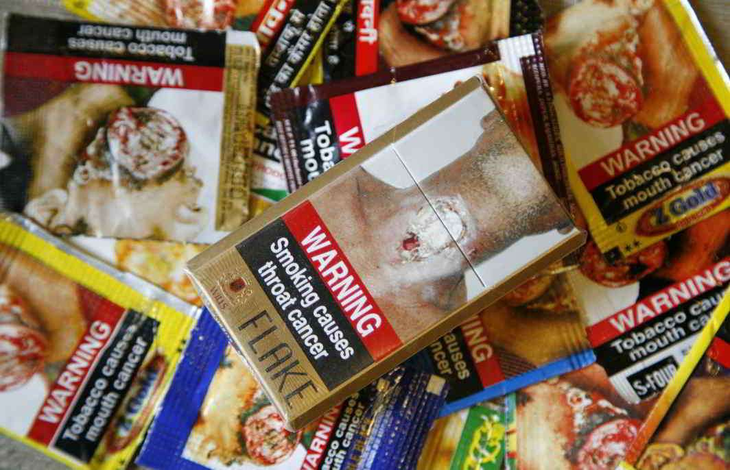 Big warnings on tobacco packs to stay