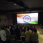 People singing national anthem in a cinema hall/Photo: YouTube