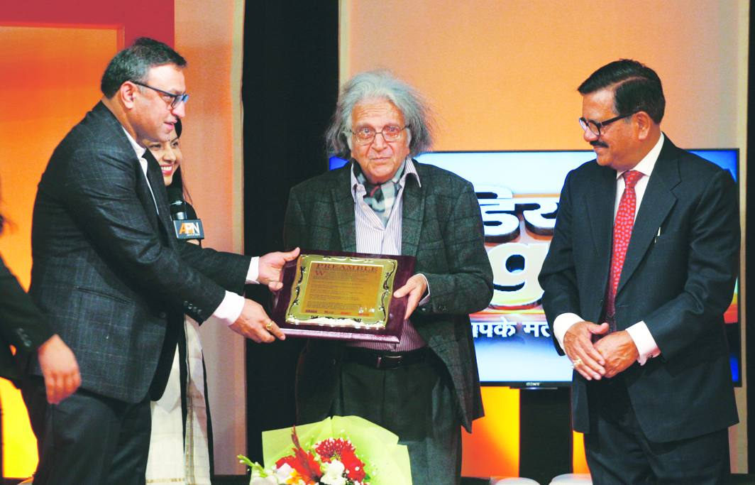 Senior advocate Supreme Court and Chairman, ILRF, Pradeep Rai, felicitating Dr Upendra Baxi at the conclave as Justice Shiva Kirti Singh looks on