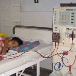 A young kidney patient undergoing dialysis, which helps to purify the blood