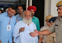 Police escort spiritual leader Asaram Bapu (Centre) outside an airport after his arrest in Jodhpur, on September 1, 2013Photo UNI