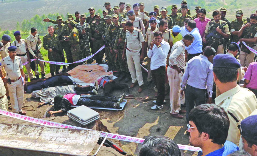 Cops at the site where eight SIMI men were shot after a Bhopal jailbreak. A recent report says SIMI activists are kept there in solitary confinement. Photo: UNI