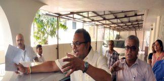 Karti Chidambaram talks to supporters during the CBI raid at his Chennai home