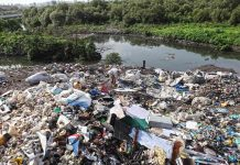 Plastic waste piled up near a drain in Mumbai