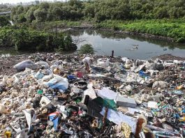 Plastic waste piled up near a drain in Mumbai