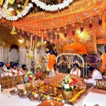 Granthis with the Shri Guru Granth Sahib in the inner sanctum sanctorum of the Golden Temple in Amritsar