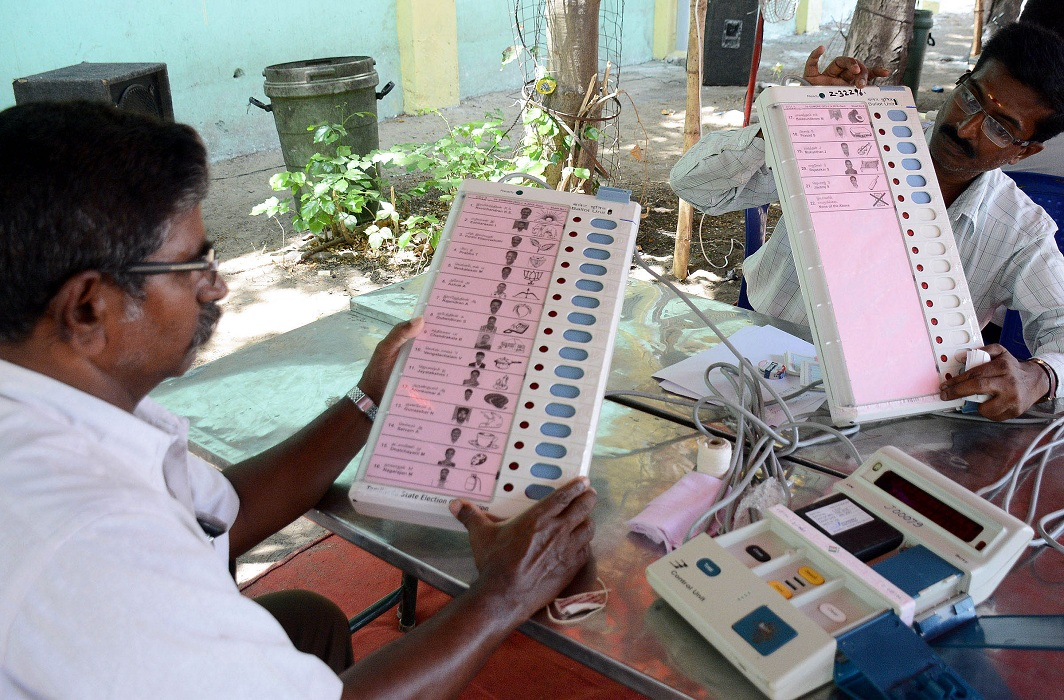 Election officials pasting name and symbol on EVMs before dispatching to the polling booths ahead of Tamil Nadu Assembly Elections, in Chennai on Tuesday (file pic)/Photo: UNI