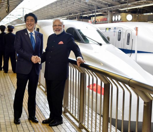 Prime Minister Narendra Modi and Prime Minister of Japan Shinzo Abe at Tokyo Station to board the Shinkansen bullet train to Kobe, in Japan (file pic)/Photo:UNI