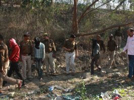 Police take the accused to the crime scene in a rape and murder case in Lucknow/Photo: UNI
