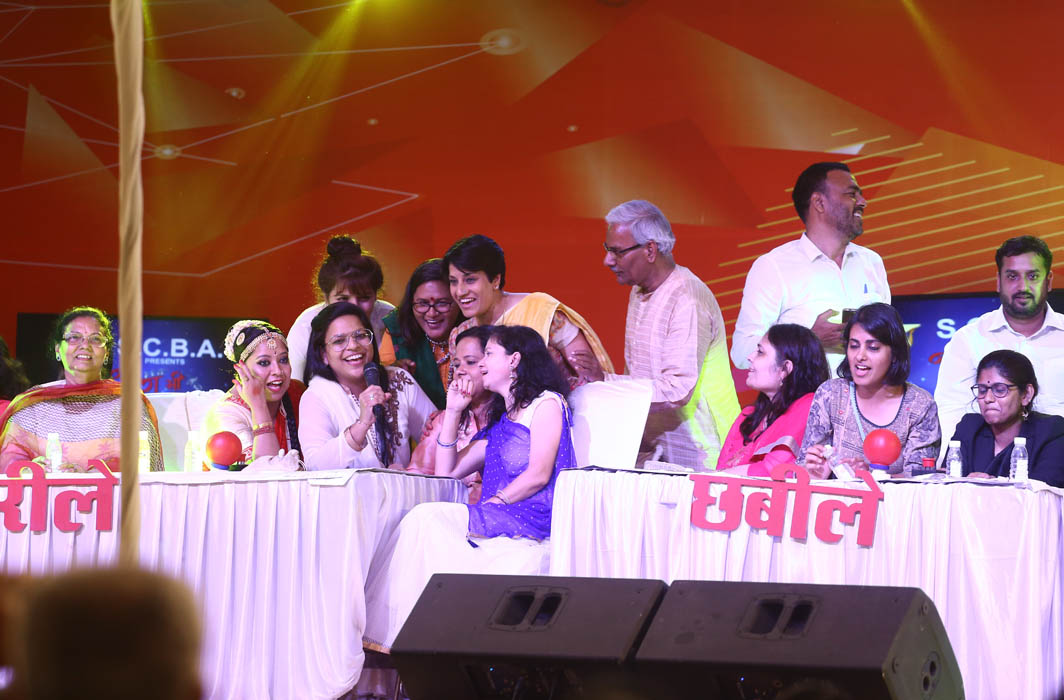 Contesting teams taking on each other in the Antakshari segment of the show