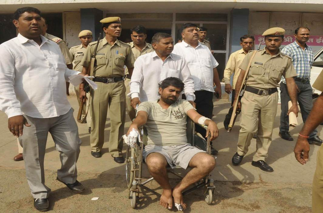 A Dalit man (in wheelchair) whose two children were burnt alive in a village in Faridabad district; past NCRB data shows a rise in the number of atrocities against Dalits/Photo: UNI