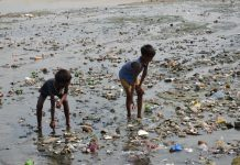 Solid waste and other filth thrown into the Ganga following the Kumbh Mela/Photo: UNI