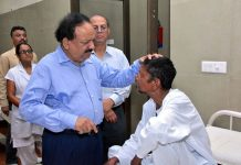 Former Union Health Minister Dr Harsh Vardhan interacting with a leprosy patient/Photo: UNI
