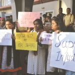 Activists holding a protest after the panel gave a clean chit to the CJI/Photo: UNI