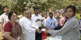Union minister Thawar Chand Gehlot (centre) distributing licences at a training programme on motor driving in 2015/Photo: UNI