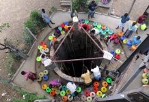 People fill plastic pots from a well in Chennai which is experiencing severe water crisis; a restaurant in the city remains shut due to water shortage/Photo: UNI