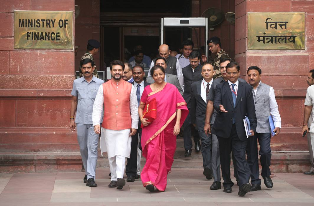 Finance Minister Nirmala Sitharaman on the way to present her maiden budget/Above: UNI