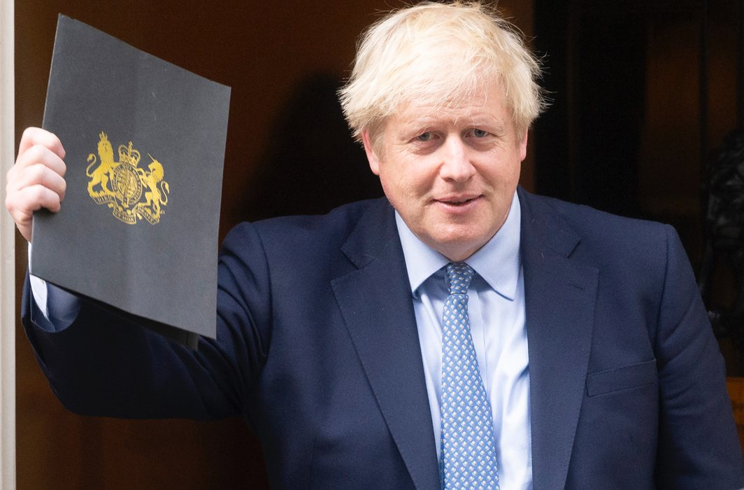 British PM Boris Johnson leaves 10 Downing Street to attend the reopening of parliament/Photo: UNI