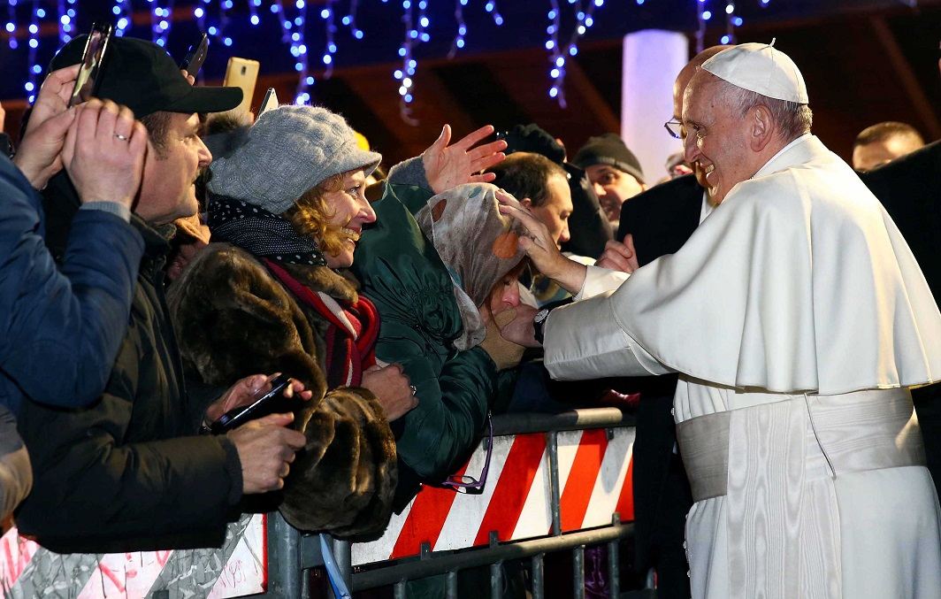DIVINE ASSURANCE: Pope Francis blesses a woman as he leaves the Roman parish of Santa Maria a Setteville di Guidonia on the outskirts of Rome on January 15, Reuters/UNI