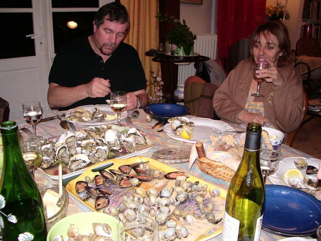 Enjoying a meal of fresh snails and oysters at home