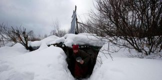 """HIDEY HOLE: Yury Alekseyev, a former lawyer from Moscow who is called a """"Russian hobbit"""", leaves his underground home in the forest on the side of the road northeast from Moscow, Russia, February 3, Reuters/UNI"""