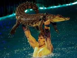 BECAUSE HE CAN: A crocodile and its tamer perform during the presentation of the new show, Water and Fire, at National Circus in Kiev, Ukraine, Reuters/UNI