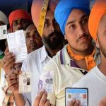Voters wait in queue to casting vote during Punjab assembly polls at a polling station in Hoshiarpur on February 4, UNI