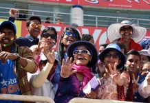 WE WANT VICTORY: Cricket fans cheer during the third day of the third Test against Australia at JSCA stadium in Ranchi, UNI