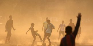 BEAUTIFUL GAME: Boys vie for the ball during soccer practice at a park in Mumbai, Reuters/UNI