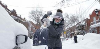 ICE, ICE BABY: A woman shovels snow away from her car after a storm in Quebec, Reuters/UNI