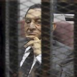 CHEATER OF MISFORTUNE: Egypt's ousted president Hosni Mubarak inside a dock at the police academy on the outskirts of Cairo in 2014. An Egyptian court sentenced him to three years in prison on charges of stealing public funds, Reuters/UNI