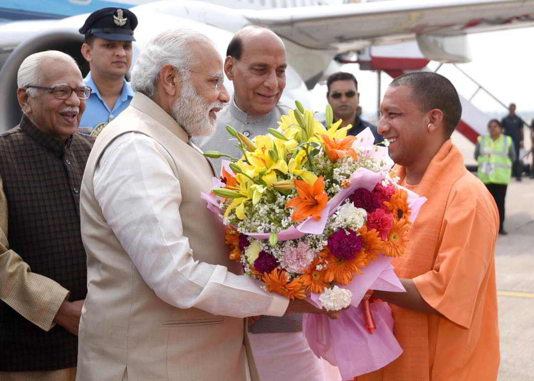 CHANGING EQUATIONS: Uttar Pradesh Chief Minister designate Adityanath Yogi receives Prime Minister Narendra Modi ahead of the swearing-in ceremony in presence of Governor Ram Naik and Home Minister Rajnath Singh
