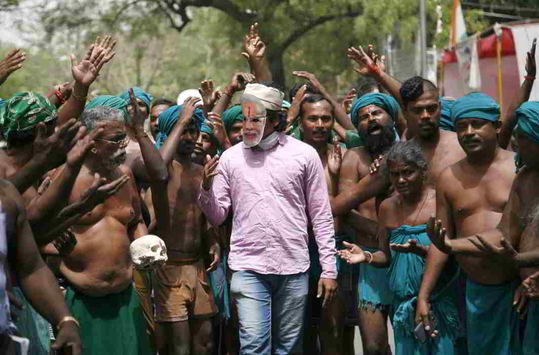 UNIQUE PROTEST: Farmers present their case before an authority figure, symbolised by a man in a Modi mask