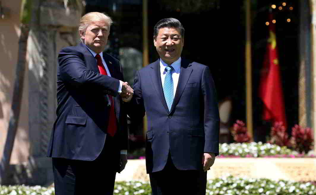 MEETING OF INTERESTS: US President Donald Trump and China's President Xi Jinping shake hands while walking at Mar-a-Lago estate after a bilateral meeting in Palm Beach, Florida, Reuters/UNI